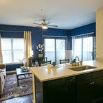 Axis West Campus - Furnished Living Room and Kitchen